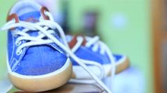 Children's blue jeans denim gumshoes Stock Footage