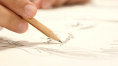 Close Up of Hand with Pencil Drawing Sketch on Paper Stock Footage