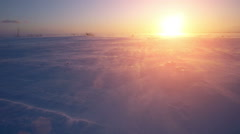 Snowstorm, wind and sun. Cold arctic. Frozen snow drifts Stock Footage