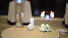 Table for two setup with glasses and candle Stock Footage