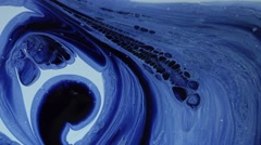 Mixing blue and white paint Stock Footage