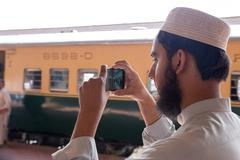 PESHAWAR, PAKISTAN - Sept 27: A student of Islamic school capture a Video on Stock Photos