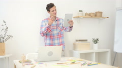 Happy young man having a video chat , desiner sharing online  ideas Stock Footage
