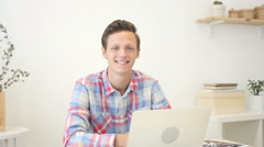 Portrait of a fashionable young professional man in a stylish creative office  Stock Footage