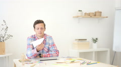 Young man Holding Paper Plane, Thinking an Idea Stock Footage