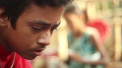 Closeup of Indian boy studying and concentrating Stock Footage