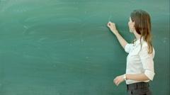 Learn science or chemistry formula confident beautiful woman teacher chalk - stock footage