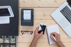 Businessman calculating his business cash flow Stock Photos