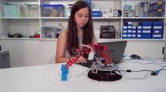 School girl in robotics laboratory. industrial robot model. Stock Footage