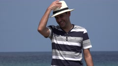 Happy Male Tourist With Hat Waving On Summer Holiday Stock Footage