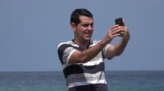 Goofy Tourist Man Taking Selfies And Having Fun Stock Footage