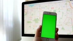 Man using iphone with various hand gestures with google map background Stock Footage