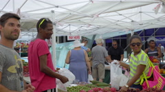 Customer picking fresh veggies on Lincoln Rd, Miami Beach Stock Footage