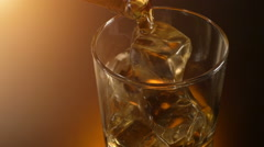 Barman pouring whiskey in the glass with reflection , warm evening atmosphere Stock Footage