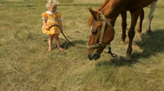 Girl and horse outdoors Stock Footage