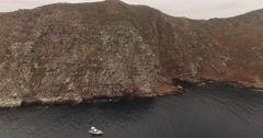 Island & Boat Aerial Shot Rising Up Stock Footage