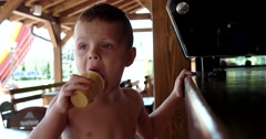 Portrait of Cute Boy Eating Ice Cream, Funny Child Busy With Dessert Stock Footage