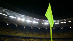 Detail with corner flag post blown by wind on soccer stadium at night Stock Footage