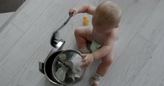 Little Chef Boy in the Kitchen Playing With Pan, Pots and Ladle Stock Footage