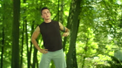 Fitness man doing stretching exercises outdoor. Fitness workout outdoor Stock Footage