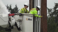 Linemen Removing Clamps From PVC Tubing Stock Footage