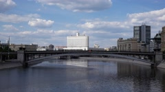 Steel arch of metro bridge span Moscow river, Russian White house at background Stock Footage