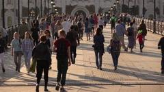 People walk on pedestrian Patriarshy Bridge, slow motion Stock Footage
