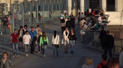 People walk Patriarshy Bridge, sit on parapet relaxing enjoying, slow motion Stock Footage