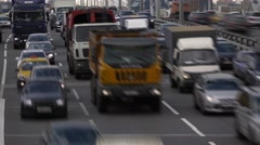 Rapid vehicle traffic rush towards, busy four lane highway, time lapse shot Stock Footage