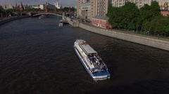 Reach of Moscow river near Kremlin, tilt up from touristic river boat Stock Footage