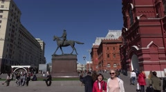 Tracking shot of monument to Marshal Zhukov and State Historical Museum Stock Footage