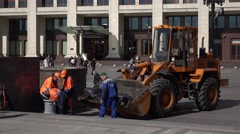 Public utility service, workers clean Moscow street against office building Stock Footage