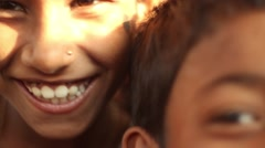 Closeup of childrens smiling faces in an Indian village school close up tilt - stock footage
