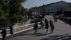Manezhnaya Square pedestrian space with fountains, walking people and gardens Stock Footage