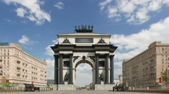 Clouds shadow fall on Triumphal Arch of Moscow, city landmark time lapse shot Stock Footage