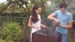 couple near the barbecue. - stock footage