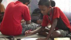 Boy students diligently study, in a village school in Bengal, India. Stock Footage