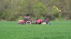 Gera. Germany 05.30.2013 - Tractor in field young shoots otvrediteley sprinkl Stock Footage