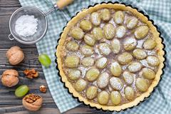 Shortbread dough grape tart with walnut praline, top view, horizontal Stock Photos