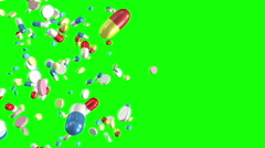 Pills falling Green Screen. Loop section from 10 seconds to 20 seconds. Stock Footage