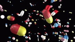 Pills falling. Loop from 10 seconds to 20 seconds. Luma matte (alpha channel). - stock footage