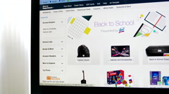 Close up man browsing on amazon back to school list Stock Footage
