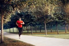 Man Running in Outdoor Jogging Training Routine Stock Photos