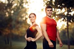 Fitness Man and Woman Standing Outside in Nature Stock Photos