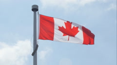 Canadian flag blowing in the wind. Clouds moving behind. Stock Footage