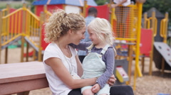 4K Portrait smiling mother & daughter at outdoor adventure playground Stock Footage