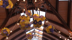 Chandelier is richly decorated with garlands made from artificial flowers Stock Footage