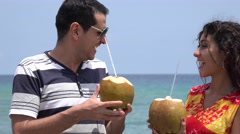 Married Couple Drinking Tropical Fruit Drinks Stock Footage