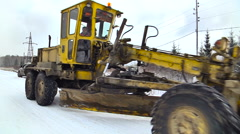 Grader Moving on the Road. Winter Forest. Close up Stock Footage