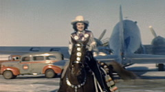 USA 1947: cowgirl riding a horse at the airport Stock Footage